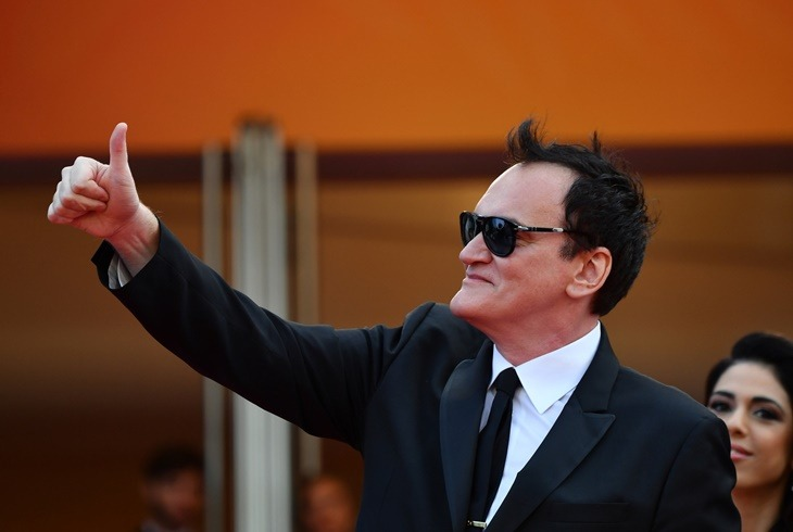 "US film director Quentin Tarantino gives a thumbs-up as he arrives for the screening of the film ""Once Upon a Time... in Hollywood"" at the 72nd edition of the Cannes Film Festival in Cannes, southern France, on May 21, 2019. (Photo by Alberto PIZZOLI / AFP)"
